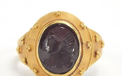 Antique unmarked gold intaglio silver ring carved with a gla...