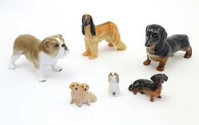 Five assorted Beswick dogs comprising Afghan Hound