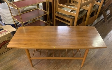 Mid century coffee table with ladder style magazine rack.