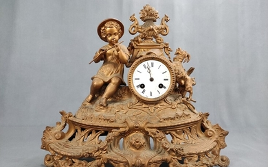 Table clock/chimney clock with boy playing the flute, goat to the left, body decorated with floral