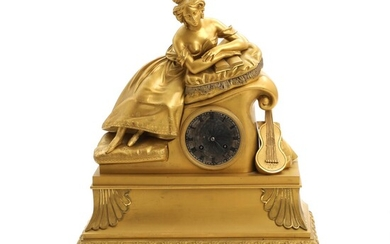 NOT SOLD. A 19th century French bronze mantel clock, surmounted by a reading lady. H. 48 cm. – Bruun Rasmussen Auctioneers of Fine Art