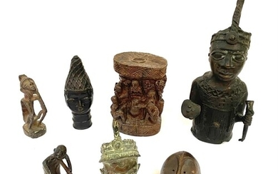 A Benin style bronze of figure of a chieftain holding a swor...