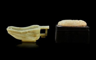A Chinese celadon jade cup, and a carved jade plaque