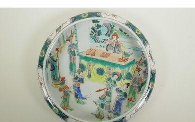 A Chinese famille verte porcelain dish with a rolled rim, de...