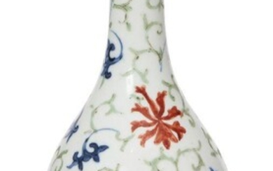 A Chinese porcelain doucai bottle vase, early 18th century, painted in doucai enamels with lotus flowers and meandering leafy scrolls, apocryphal Wanli mark to base, 15cm high, wood stand