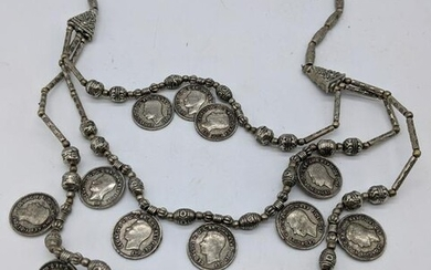 A Colonial Indian silver necklace with silver beads and