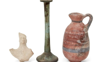 A Cypriot Iron Age black-on-red ware pottery juglet of barrel form with trefoil lip, the decoration on the body consisting of multiple encircling bands of varying width, a broad band around the base of the neck and rim, with further colour edging...