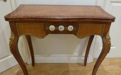 A French style inlaid rectangular games table with applied p...