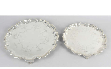 A George V silver salver with engraved swag motifs, together with a matching smaller example. (2).