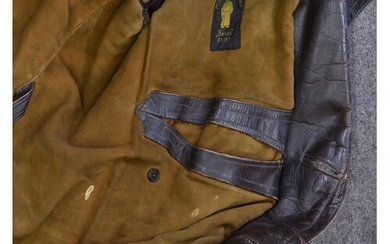 A German Army brown leather great coat, light brown suede li...