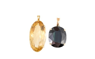 A LARGE SAPPHIRE PENDANT, (greenish hue), mounted in yellow ...