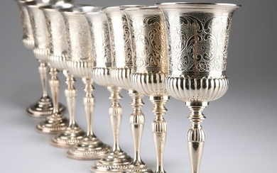 A SET OF EIGHT SILVER-PLATED GOBLETS, each campana bowl