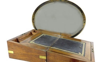 A Victorian mahogany writing slope, with brass corners and e...