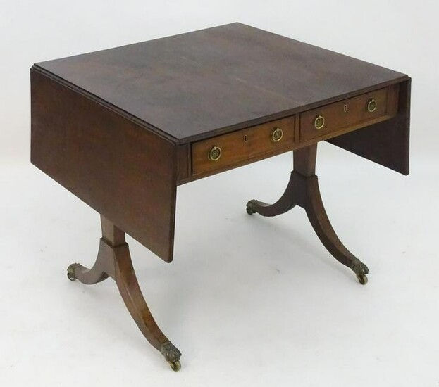 A late 18thC / early 19thC mahogany sofa table with a