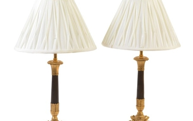 A pair of French gilt and patinated metal candlestick table lamps in Louis Philippe taste
