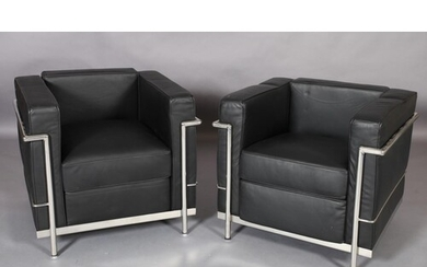 A pair of Le Corbusier LC2 style black leather and chrome fr...