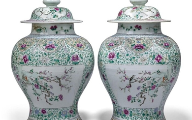 A pair of large Chinese porcelain famille rose vases and covers, late 19th century, finely painted to the body with alternating panels of flowering lotus and birds perched on flowering branches, on a ground of meandering flowering lotus scrolls...
