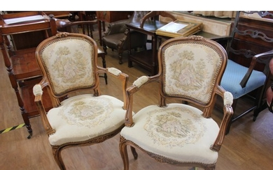 A pair of reproduction carved beech fauteuils with tapestry ...