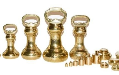 A quantity of assorted brass weights including bell formed examples...
