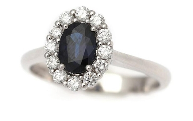 NOT SOLD. A sapphire and diamond ring set with an oval-cut sapphire encircled by numerous brilliant-cut diamonds, mounted in 18k white gold. Size 53. – Bruun Rasmussen Auctioneers of Fine Art