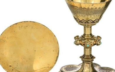 A silver and gilt silver Gothic Revival chalice splendidly engraved...