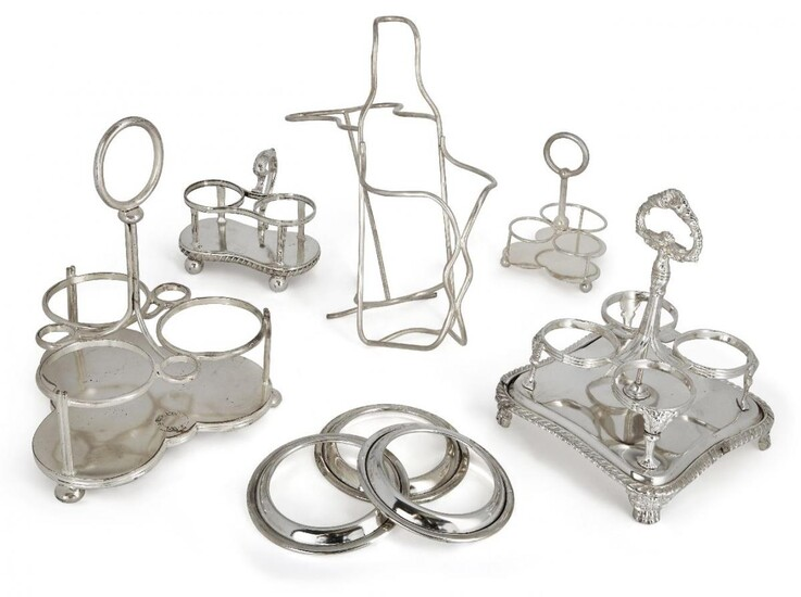 A silver plated wine bottle coaster, together with a collection of silver plated cruet stands, most with Athenaeum Club crest, and eleven silver plated dish stands (a lot)