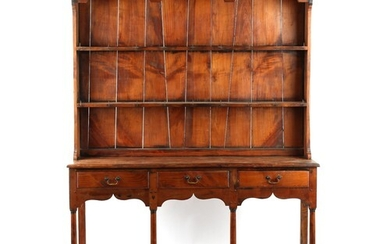 A solid yew wood two part Welsh dresser, 20th century, 62ins...