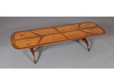 A walnut and zebrawood coffee table, c.1960/70s, veneered in...