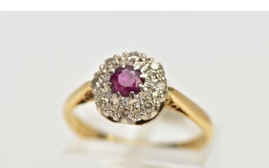 AN 18CT GOLD RUBY AND DIAMOND CLUSTER RING, centring on a ci...