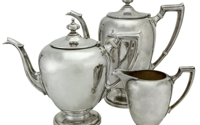 An American Silver Three Piece Tea Service by Reed and Barton Comprising: tea pot, hot water/c...