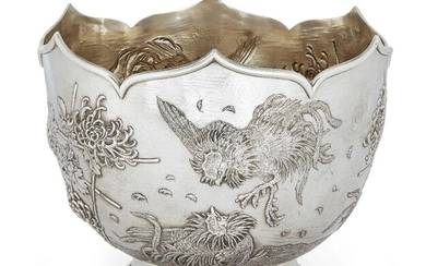 An Edwardian silver punch/rose bowl, London, c.1905, C. F. Hancock & Co., of circular form with shaped rim, the repousse sides decorated with fighting cocks, bamboo and blooming flower motifs, gilded interior, 27.3cm dia., 21cm high, approx. weight...