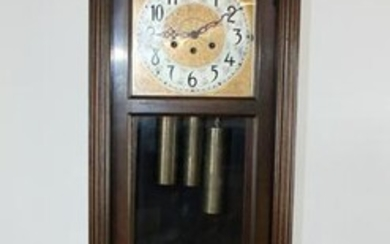 Colonial Mfg Co Grandfather clock with brass face