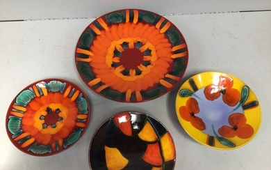 Four various Poole Pottery items including a large 'Volcano'...