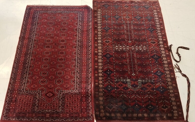 TWO RUGS hand-knotted with geometrical forms, dominant red, one long....