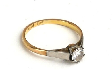 A 18CT GOLD AND DIAMOND SOLITAIRE RING Having a single round...
