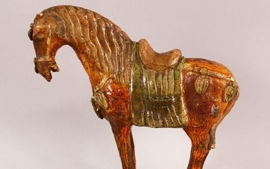A CHINESE TANG STYLE SANCAI POTTERY MODEL OF A HORSE, 25cm