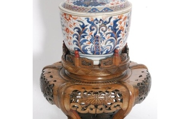 A Chinese 18th/19th Century Imari jar and cover, rising from...