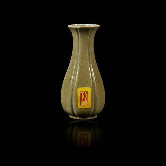 A Chinese grey-green-glazed lobed miniature vase