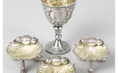 A George IV silver communion goblet, together with three late Victorian silver shell salts. (4).