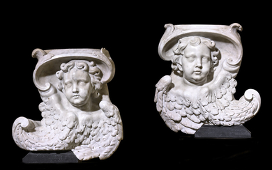 A PAIR OF BAROQUE CARVED MARBLE ANGEL CORBELS
