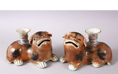 A PAIR OF CHINESE 18TH / 19TH CENTURY FAMILLE ROSE DOG FORME...