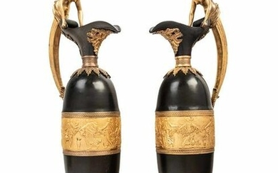 A Pair of Continental Gilt and Patinated Bronze Ewers