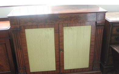 A Regency style mahogany side cabinet, fitted a drawer, abov...