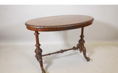 A Victorian burr walnut stretcher table, the oval top with c...