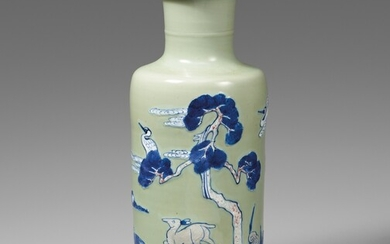 A blue and white, underglaze copper-red and white-slip-decorated celadon-ground rouleau vase. Kangxi period (1662-1722)