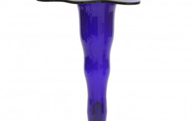 A blue glass vase of wavy design, both for the body as well as the top rim, unsigned.