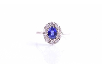 A diamond and sapphire cluster ring, set with a mixed oval-c...