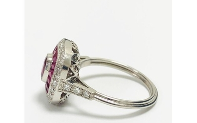 A large 18ct white gold ring set with a large oval pink tour...