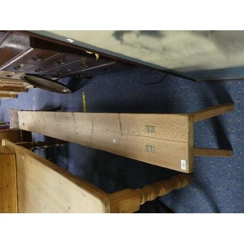 A large 20thC pine Bench, 97in (246cm) long x 9in (23cm) dee...