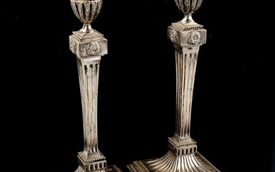 A pair of Dutch silver table candlesticks, fluted decoration...